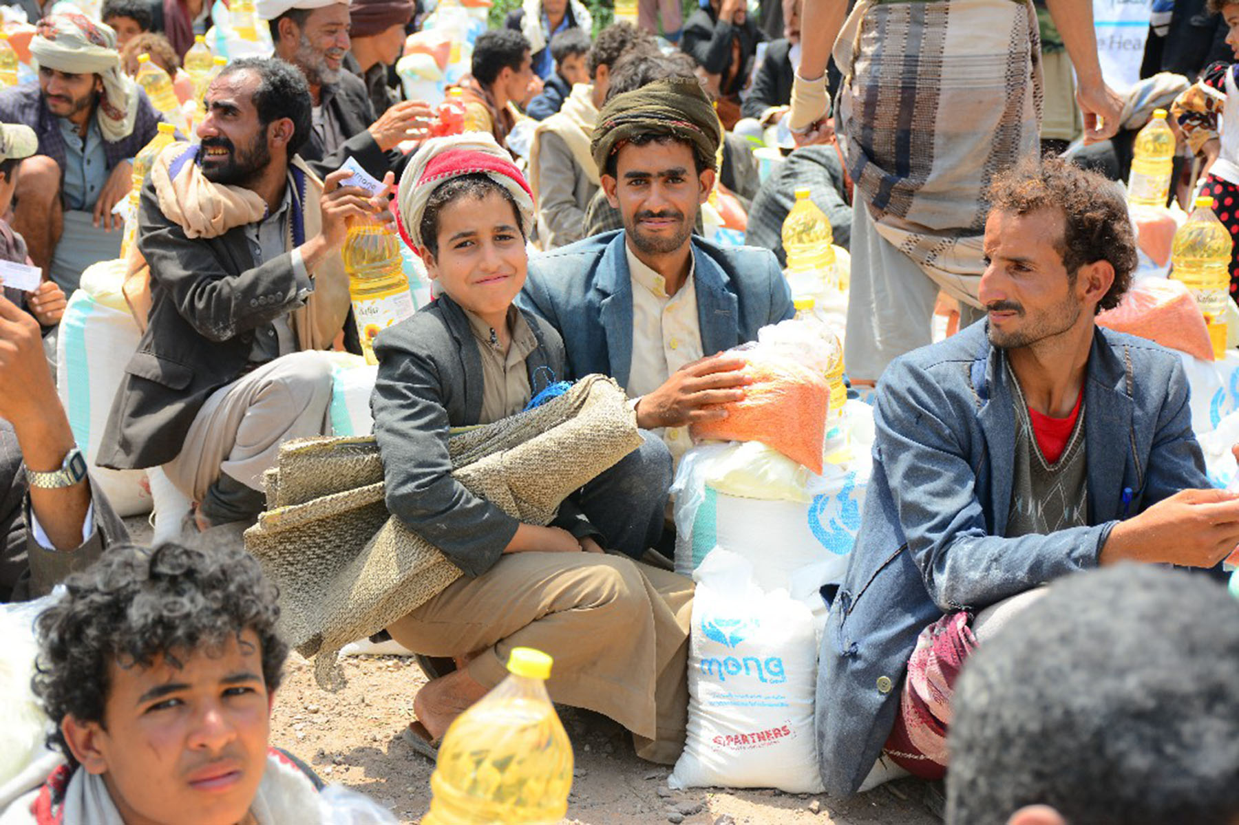 Families wait with parcels in Sana'a, Yemen. (Partners Relief & Development)