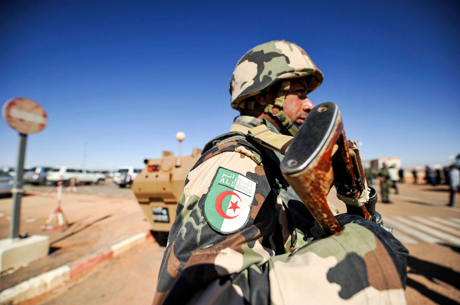 A file picture shows Algerian soldier standing guard at the Tiguentourine gas complex, in In Amenas, about 1,600 kilometres southeast of the capital. (AFP)