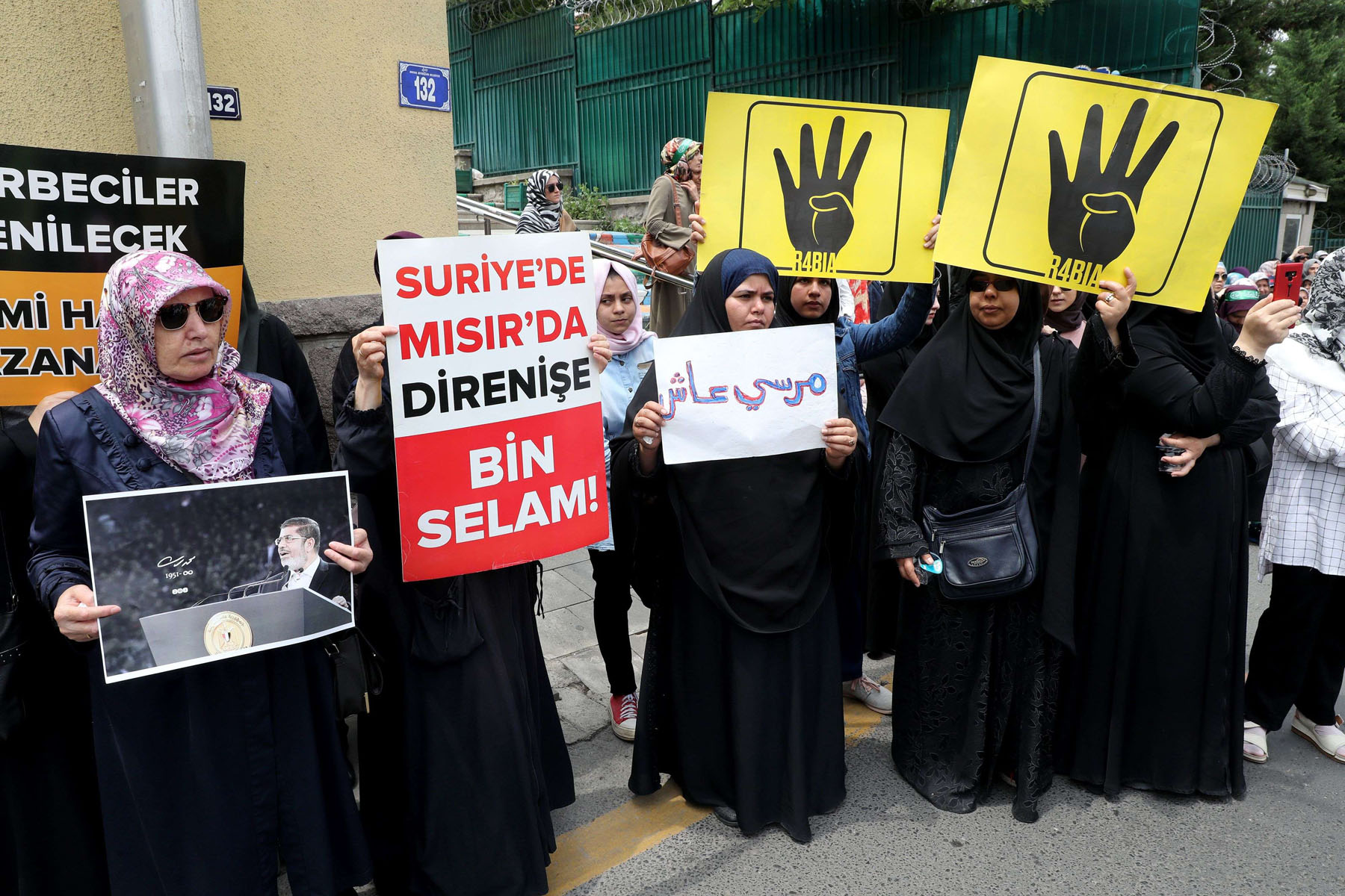 A June 2019 file picture shows demonstrators holding pro-Muslim Brotherhood signs in front of the Egyptian embassy in Ankara. (AFP)