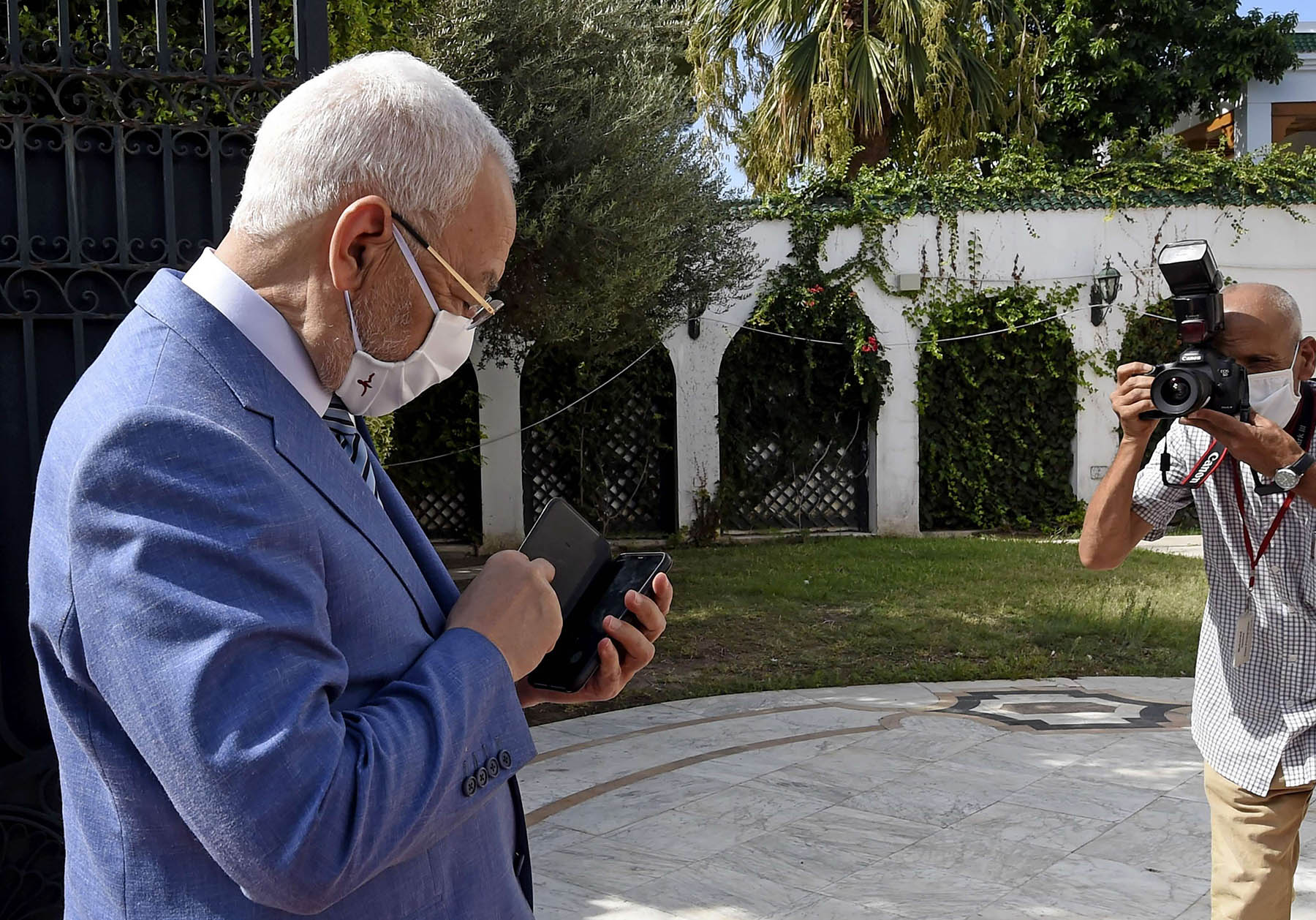 Tunisian Islamist party leader Rached Ghannouchi arrives at a government ceremony in Carthage on the eastern outskirts of the capital Tunis on September 3. (AFP)