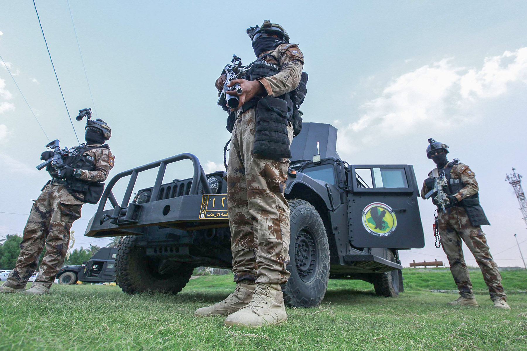 Armed members of the Iraqi Counter Terrorism Service in position during a deployment in Baghdad. (AFP)