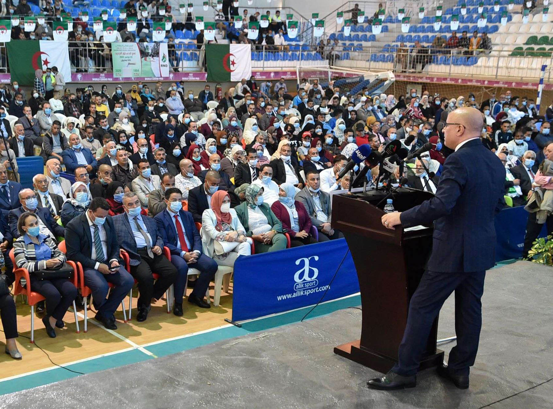 Tayeb Zitouni, the newly-elected secretary-general of the Algerian Democratic National Rally (RND) political party, speaks at an indoor rally in Algiers about the referendum scheduled for November 1. (AFP)