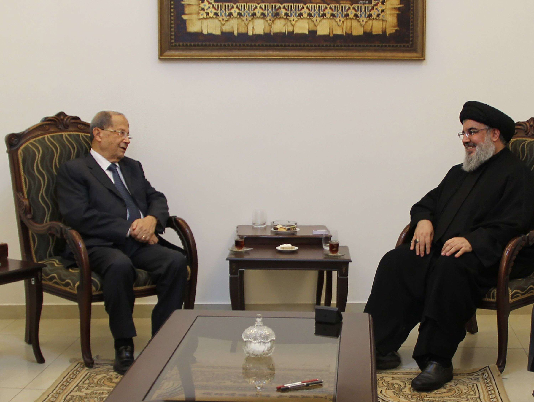 An October 2016 file picture shows Hassan Nasrallah (R), the head of Lebanon's militant Shia movement Hezbollah, meeting with General Michel Aoun at an undisclosed location in Lebanon. (AFP)