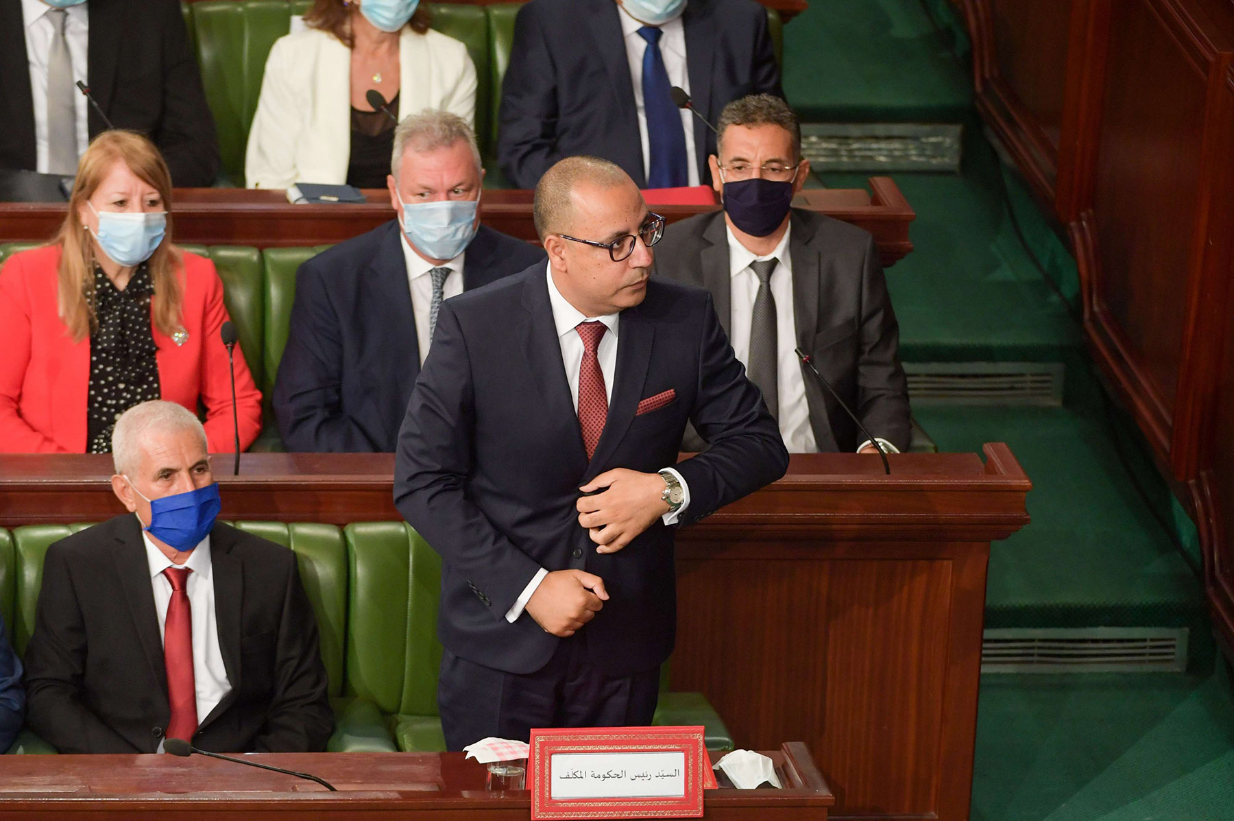 PM Hichem Mechichi stands to deliver a speech to members of parliament as they hold session of confidence in the capital Tunis on September 1. (AFP)