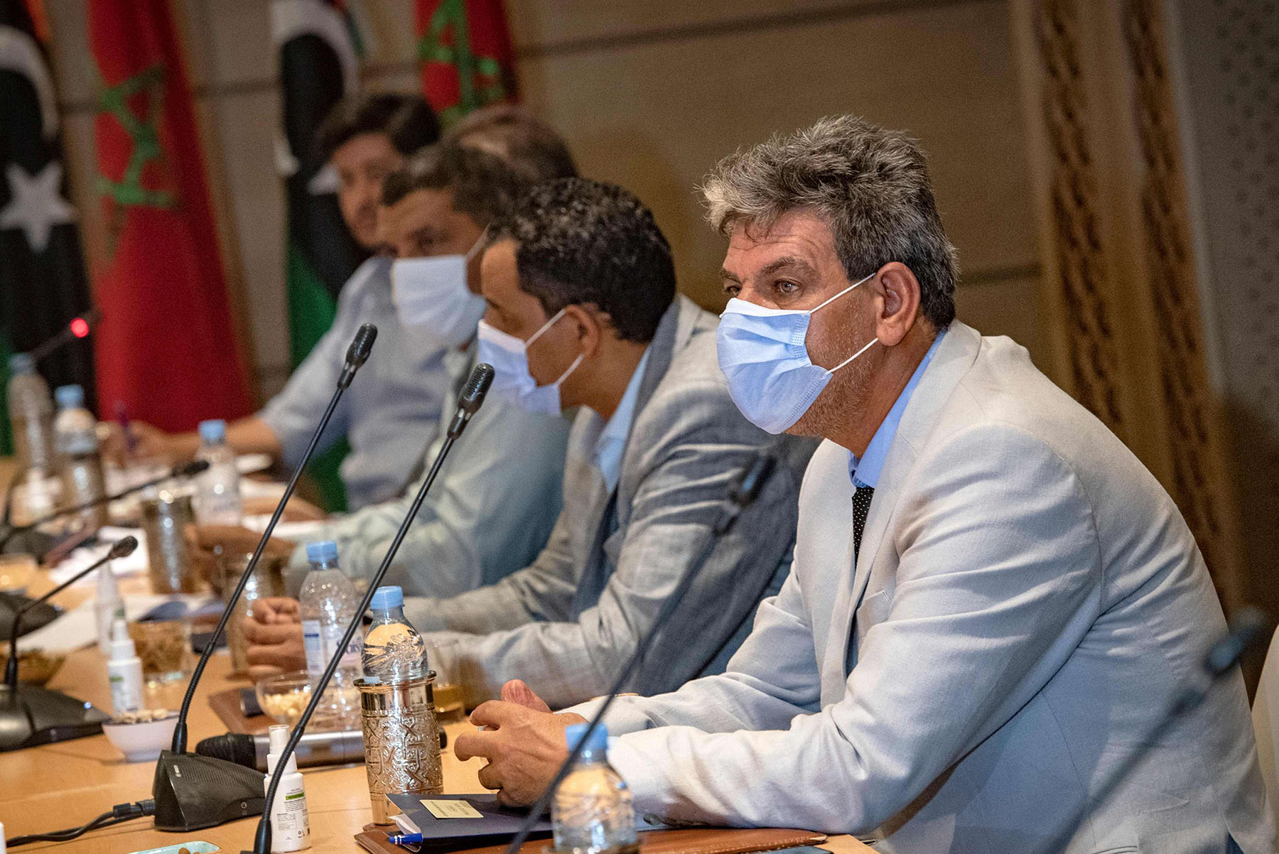 Representatives of Libya's rival administrations attend a meeting in the coastal Moroccan town of Bouznika, south of the capital Rabat, on October 3. (AFP)