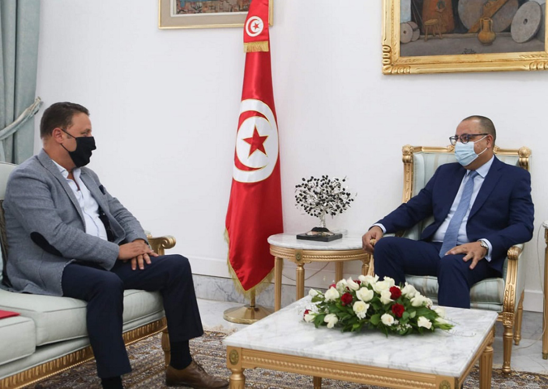 Tunisian Prime Minister Hichem Mechichi meets with People's Movement MP Haykal Mekki, October 14, in Tunis. (Prime Minister's office)