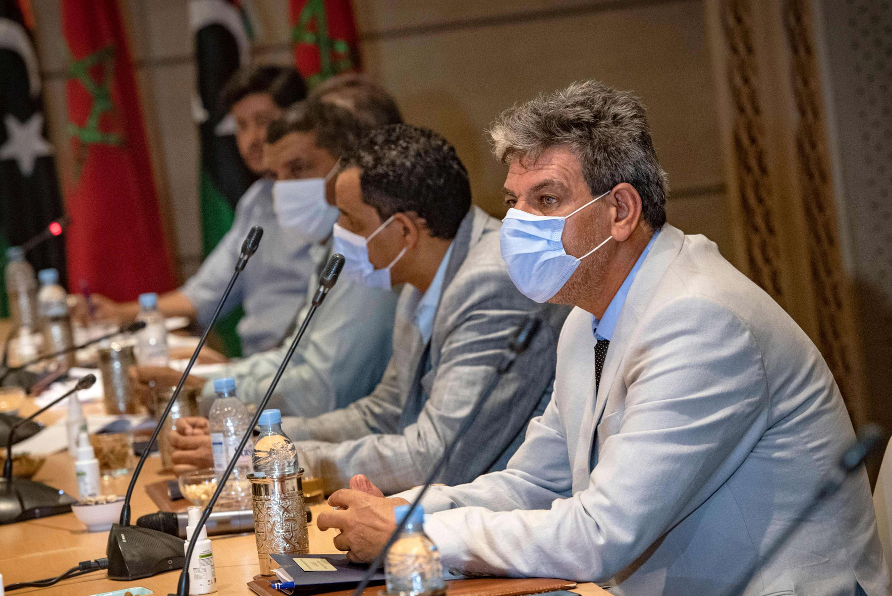 Representatives of Libya's rival administrations attend a meeting in the coastal Moroccan town of Bouznika, south of the capital Rabat, on October 3, 2020. (AFP)