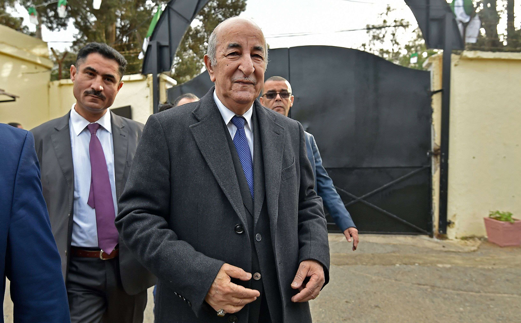A 2019 file picture of Algerian presidential candidate Abdelmadjid Tebboune (R) in the capital Algiers. (AFP)