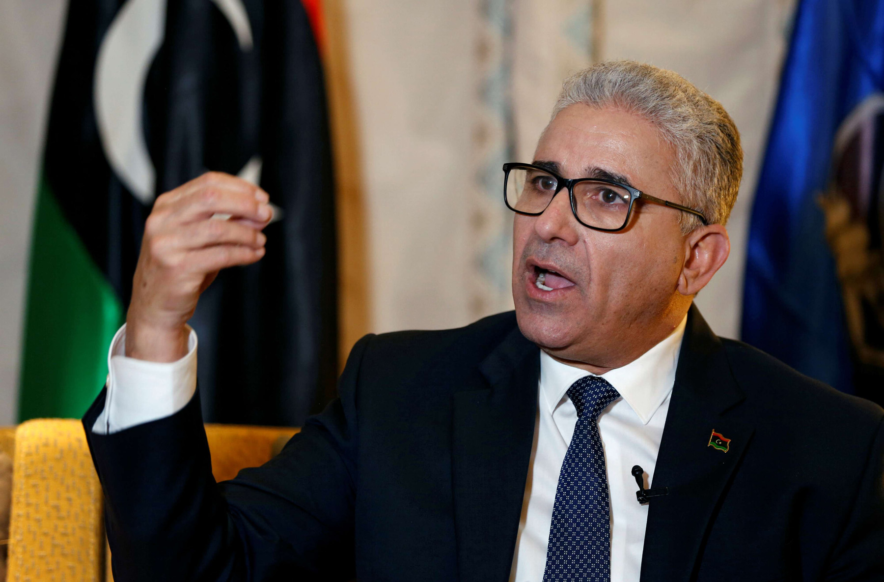 A file picture shows Libya's interior minister Fathi Bashagha speaking during a press interview in March 2020. (REUTERS)