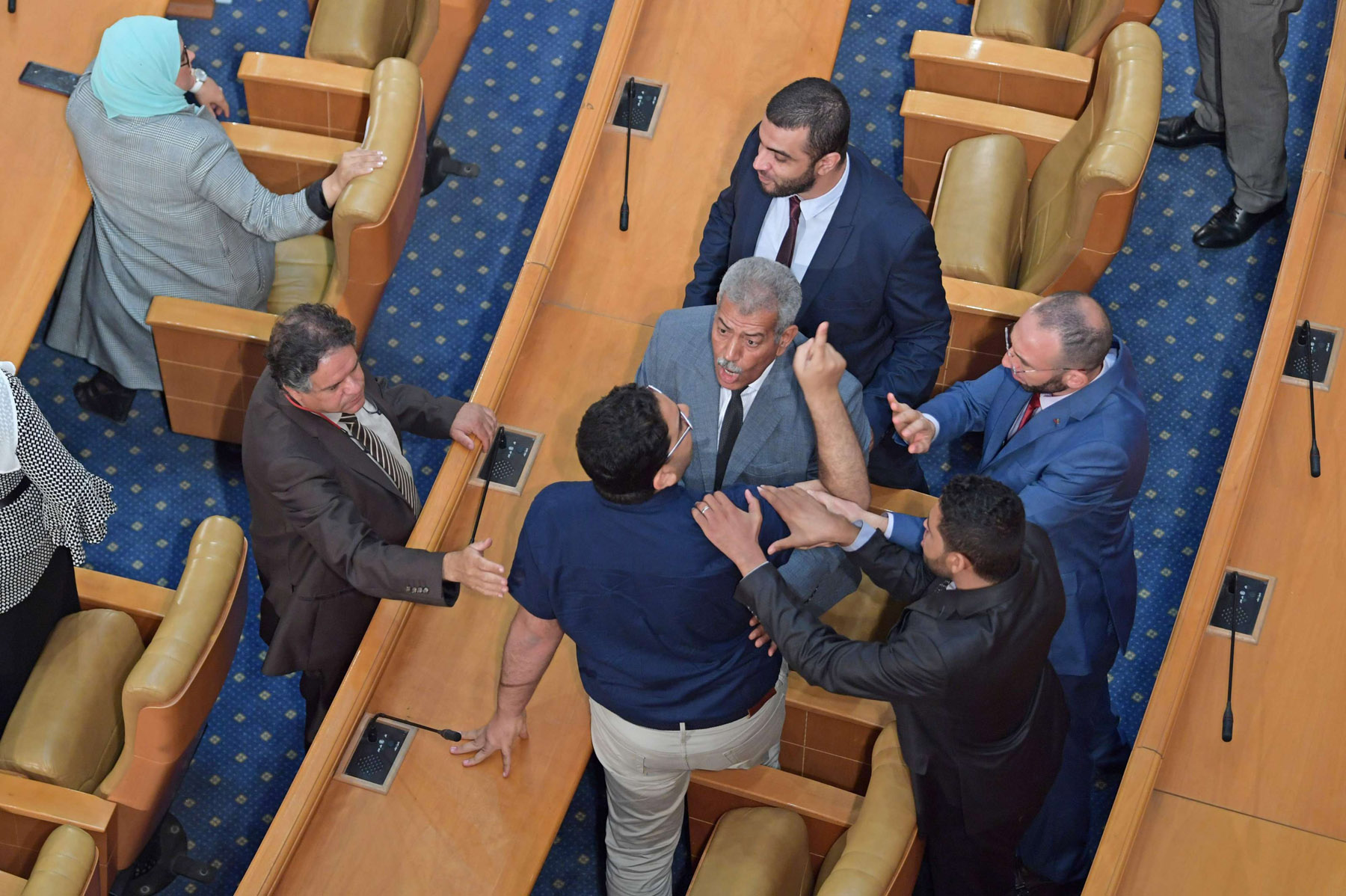 A file picture shows Tunisian MPs arguing during a plenary session, last June. AFP