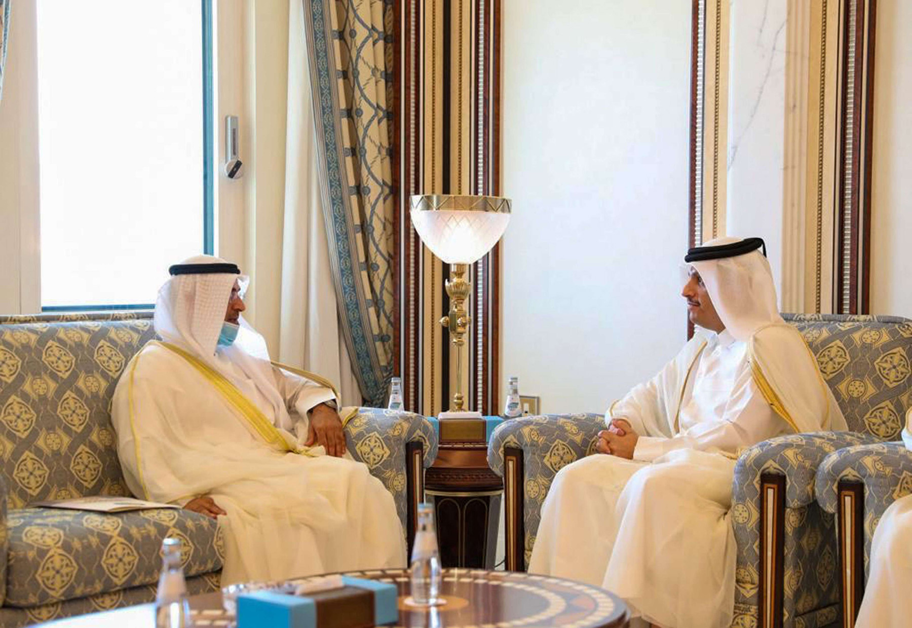 Qatari Deputy Prime Minister Mohammed bin Abdulrahman al-Thani (R) meeting with Gulf Cooperation Council (GCC) Secretary-General Abdullatif bin Rashid al-Zayani in the Qatari capital Doha, on September 21, 2020. (AFP)