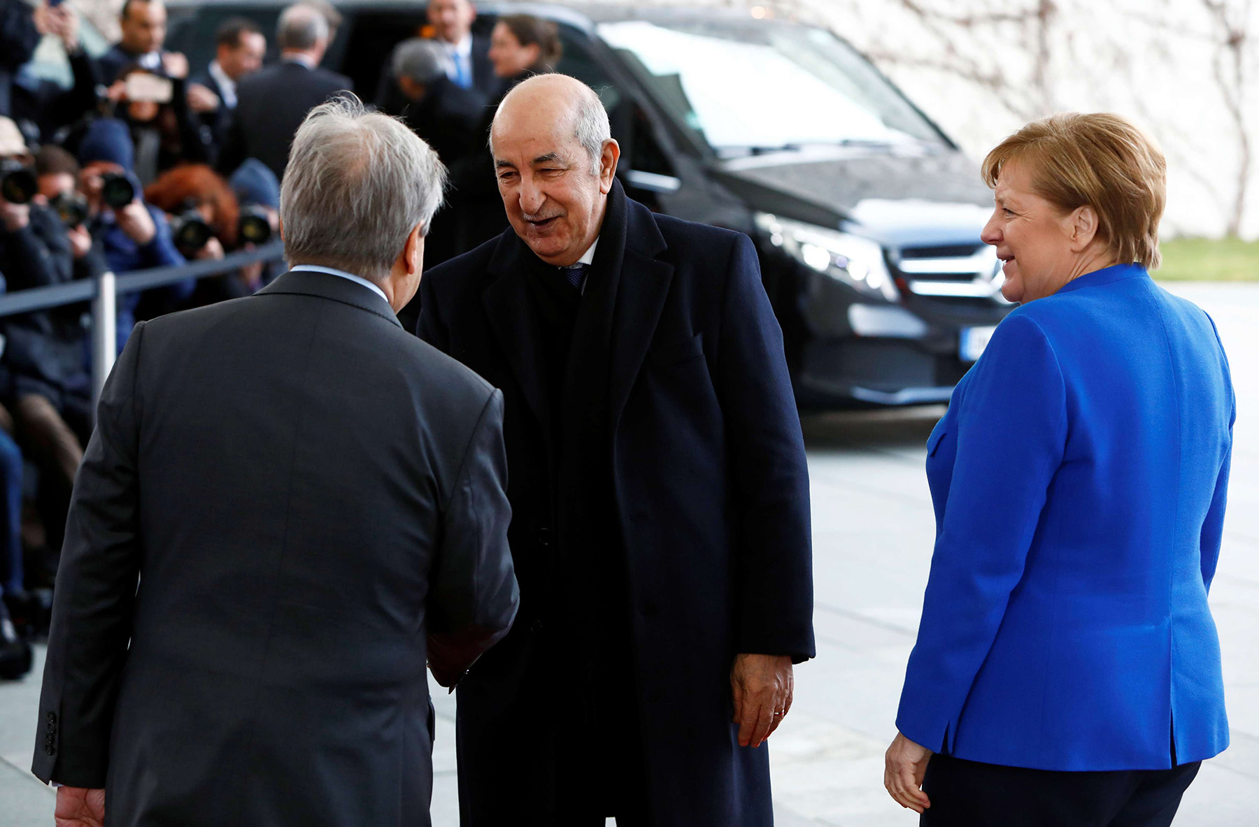 German Chancellor Angela Merkel and United Nations Secretary-General Antonio Guterres welcome Algerian President Abdelmadjid Tebboune at the Libya summit in Berlin, Germany, January 19, 2020. (REUTERS)