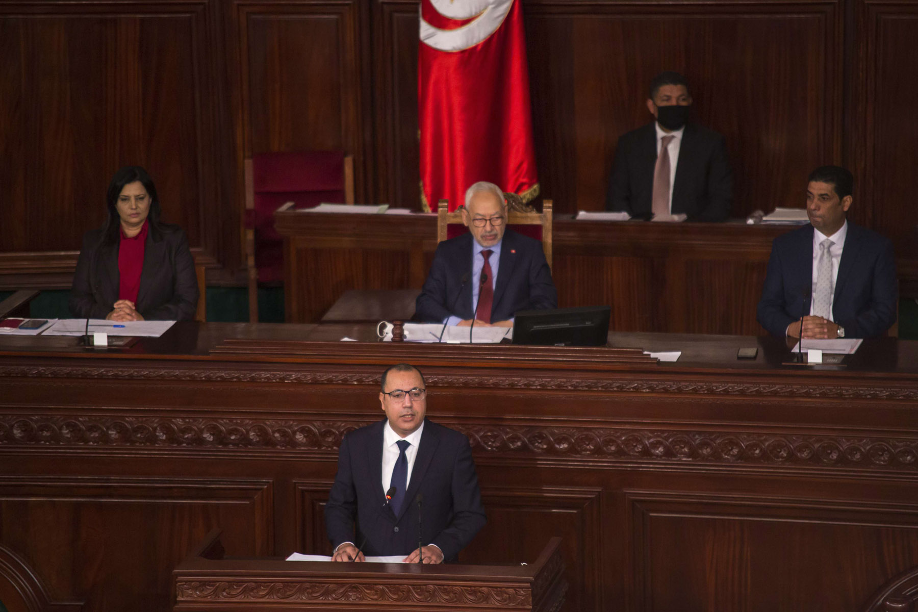 Tunisian Prime Minister Hichem Mechichi, foreground, delivers his speech in the Parliament in Tunis, Januray 26, 2020, with the speaker in the background. (AP)