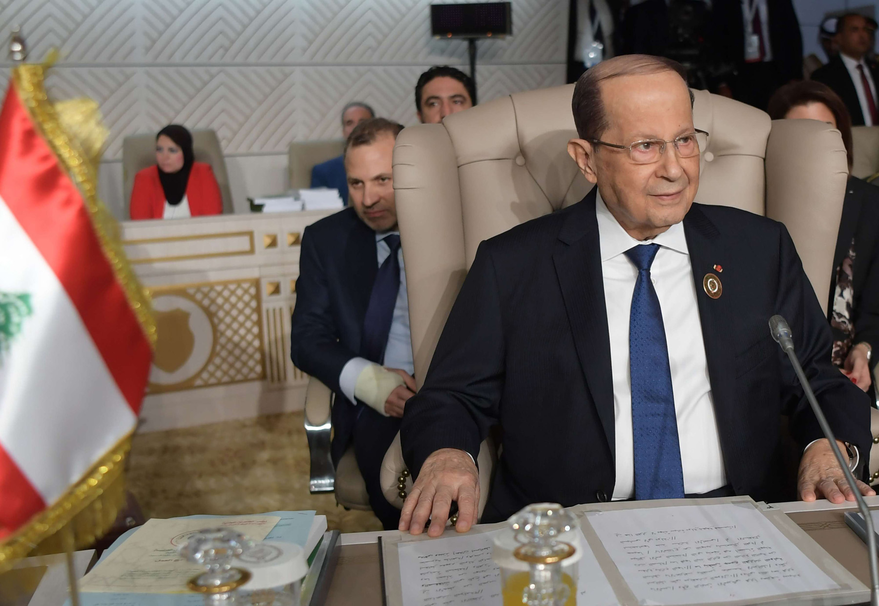 Lebanese President Michel Aoun (R) and his Foreign Minister Gibran Bassil (C) attend the opening session of the 30th Arab League summit in the Tunisian capital, Tunis, on March 31, 2019.  AFP
