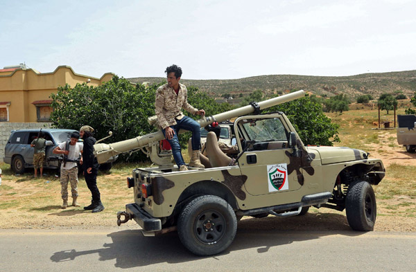 Fighters with the GNA at a position near the town of Garabulli, some 70 kms east of the capital Tripoli. (AFP)