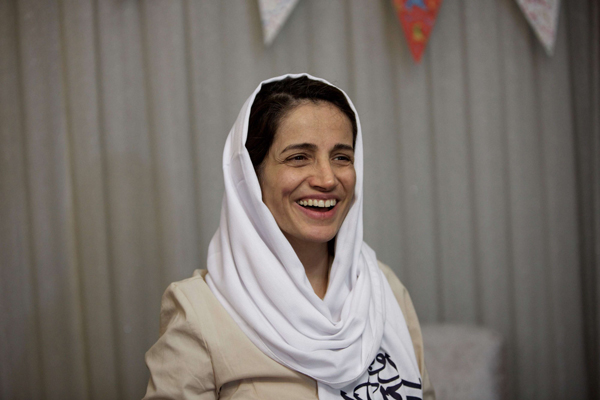 A 2013 file picture shows Iranian lawyer Nasrin Sotoudeh smiling at her home in Tehran, after being being temporarily freed following three years in prison. (AFP)