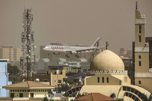 A Qatar airways plane prepares to land at Khartoum International Airport in the Sudanese capital on March 31, 2019, before the suspension of flights between the two countries. (Reuters)
