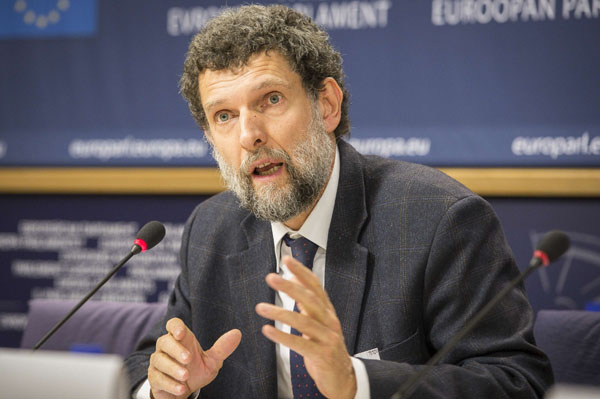 Osman Kavala, Turkish philanthropist, entrepreneur and rights defender, speaks in Brussels at a press conference at the EU Parliament in 2014.  (DPA)