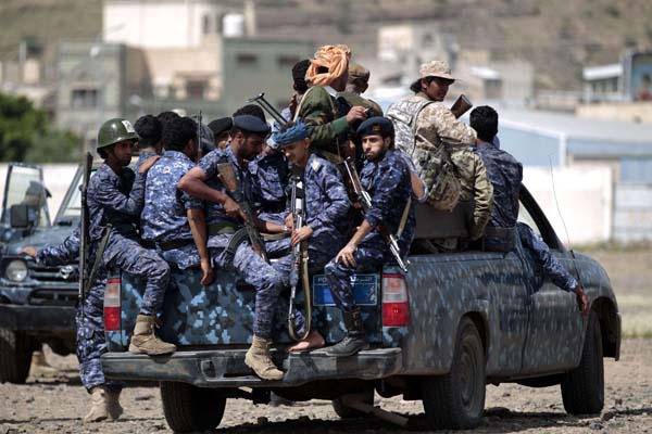 A 2019 file picture shows Yemeni Houthi police forces sit in the back of a military vehicle in the capital Sana'a.(AFP)