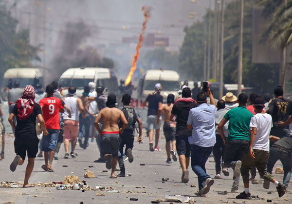 Tunisian protesters clash with security forces as they demonstrate in the southern city of Tataouine on June 22. (AFP)