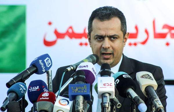 A file picture shows Yemeni Prime Minister Moeen Abdulmalik giving a press conference in the port of Aden. Reuters