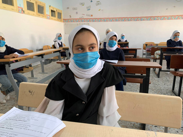 Students wear masks and keep safe distance while attending a class after some schools reopened amid the coronavirus disease crisis, in Misrata. (Reuters