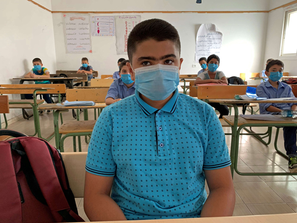 Students wearing protective face masks and maintain social distancing as they attend a class after some schools reopened amid the coronavirus disease crisis, in Misrata. Picture taken October 4, 2020. (Reuters)