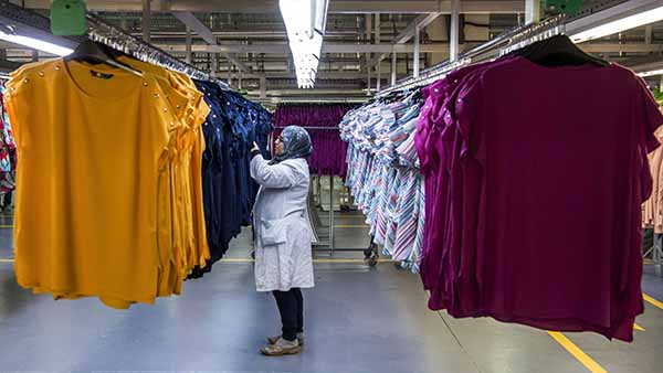 An employee of Still Nua's fashion works at a textiles factory in an industrial park connected to a free-trade zone in the Moroccan city of Tangiers. (AFP)