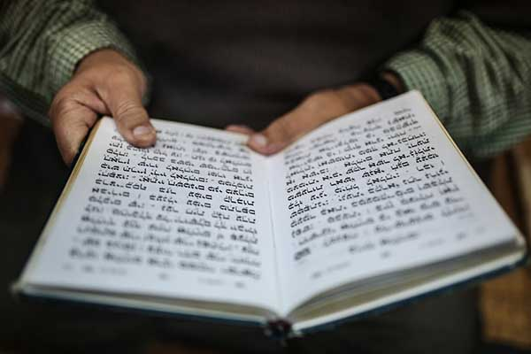 A Jewish man reads the Torah at La Ghriba, the oldest synagogue in Africa, on the Island of Djerba, southern Tunisia. (AP)