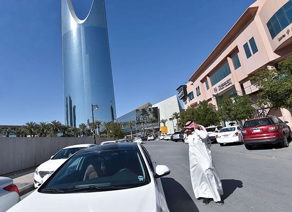 Saudi driver Hussein getting into his car to start the day working for Uber, in the capital Riyadh. (AFP)