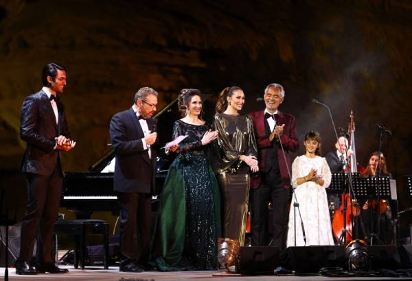 Matteo Bocelli, Eugene Kohn, Francesca Maionchi, Loren Allred, Italian tenor and opera singer Andrea Bocelli and Virginia Bocelli on stage during a concert at the Hegra World Heritage Site in the northwestern Saudi city of al-Ula on April 8, 2021. (AFP)