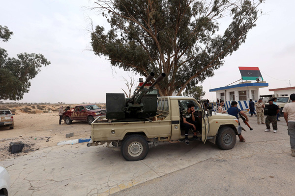 Fighters loyal to Libya's Government of National Accord after taking control of al-Watiya airbase, May 18. (REUTERS)