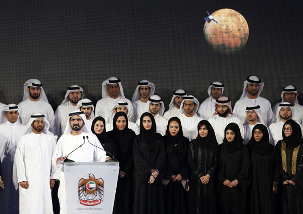 A file picture shows Sheikh Mohammed bin Rashid al-Maktoum, prime minister of the United Arab Emirates (UAE) and ruler of Dubai, speaking among engineers and scientists during a ceremony to unveil UAE's Mars Mission in Dubai. (AFP)