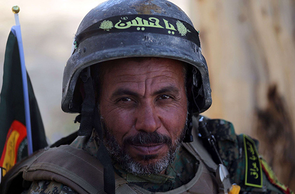 A member of the Iraqi Hashed al-Shaabi (Popular Mobilisation) paramilitary forces in Mosul. (AFP)