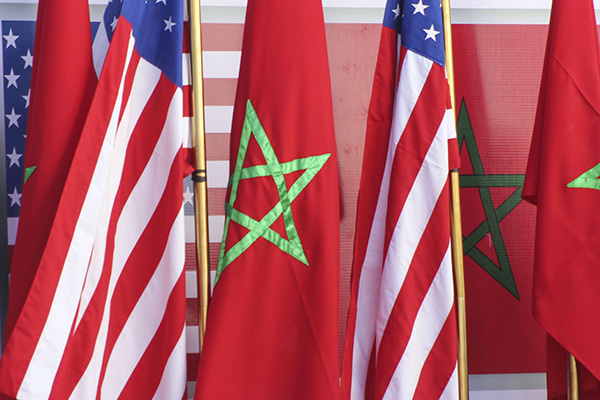 US and Moroccan flags stand together on the podium in Dakhla, Januray 10, 2021. (AP)