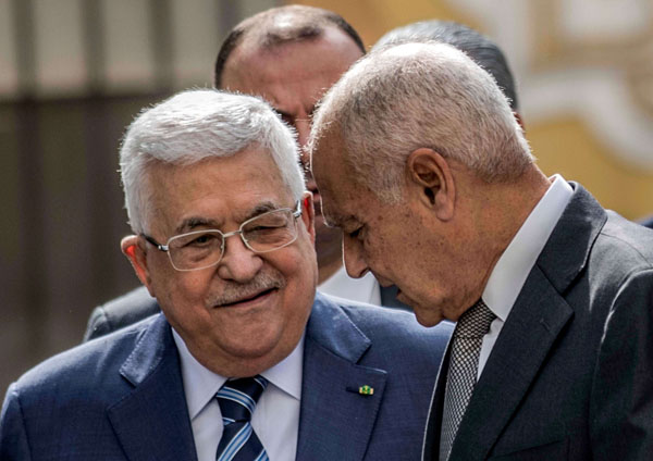 Arab League Secretary-General Ahmed Aboul Gheit speaks with Palestinian president Mahmud Abbas (L). (REUTERS)