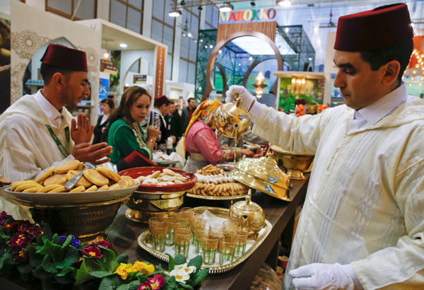 A Moroccan participant serves tea during the opening of the Green Week international food, agriculture and horticulture fair in Berlin, Germany. (Reuters)