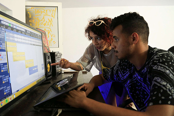 "Moroccan rapper Houda Abouz, 24, known by her stage name ""Khtek"", works on a song with her composer inside a studio in Rabat, Morocco July 20. (Reuters)"