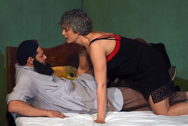 "Tunisian actress Nadia Boussetta (R) and actor Ghazi Zaghbani, depicting Narjess a prostitute and an Islamist, take part in a play entitled "" The Escape"" on March 1, 2018 in Tunis. (AFP)"
