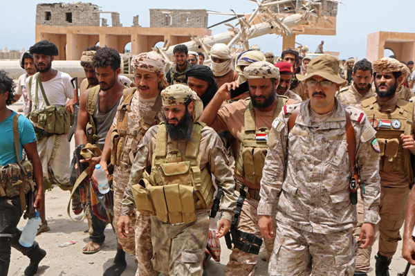 Fighters loyal to Yemen's separatist Southern Transitional Council (STC) in the southern Abyan governorate on June 24. (AFP)