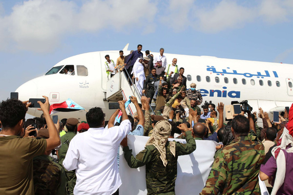People wait to greet members a newly formed cabinet upon their arrival at Aden airport, before an attack on the airport, in Aden, Yemen December 30, 2020. (REUTERS)