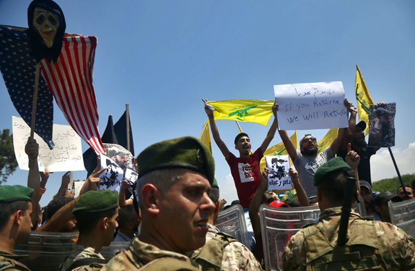 Hezbollah supporters demonstrate against the visit of Commander of the US Army Central Command, Kenneth Franklin McKenzie to Lebanon. (AFP)