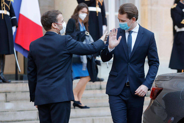 French President Emmanuel Macron walks back Austrian Chancellor Sebastian Kurz  at the Elysee Palace in Paris on November 10. (AFP)