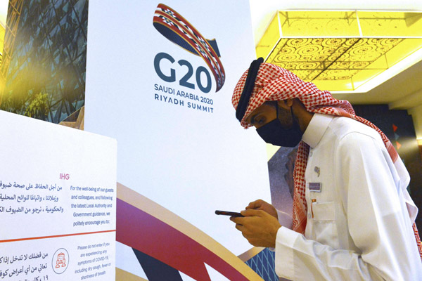 Saudi organisers prepare for the G20 nations summit in the Saudi capital Riyadh as health precautions are posted in a conference sign. AFP