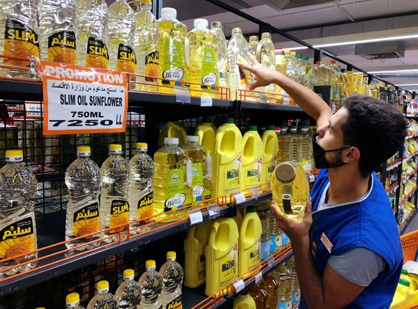 A worker arranges bottles of oil inside inside a supermarket in Beirut, Lebanon October 8, 2020.(Reuters)