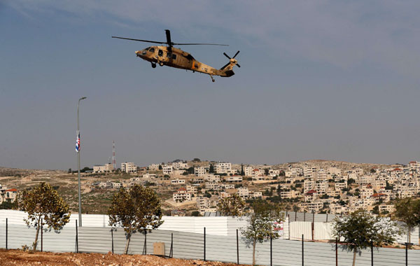 An Israeli airforce helicopter carrying US Secretary of State Mike Pompeo flies near the Israeli Psagot settlement in the occupied West Bank north of Jerusalem on November 19, 2020. (AFP)