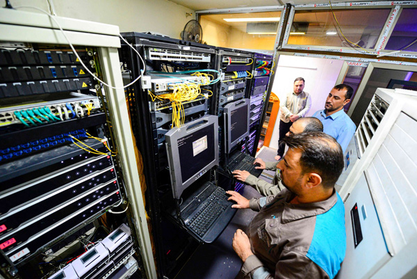 A computer technician operates a rackmount console terminal at the server room of the Imam Ali shrine in Iraq's central holy city of Najaf. (AFP)
