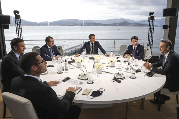 Clockwise from left, Malta's Prime Minister Robert Abela, Spain's Prime Minister Pedro Sanchez, Cyprus President Nikos Anastasiadis, France's President Emmanuel Macron, Italy's Prime Minister Giuseppe Conte and Greek Prime Minister Kyriakos Mitsotakis meet during an emergency summit in Porticcio, Corsica island, September 10. AP