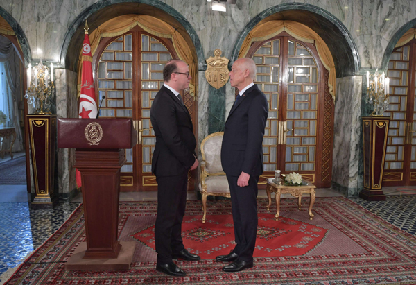 Tunisian President Kais Saied (R) stands with Prime Minister Elyes Fakhfakh at the Carthage Palace in Tunis, on February 27. Fakhfakh later resigned and was replaced by Hichem Mechichi as PM. (AFP)