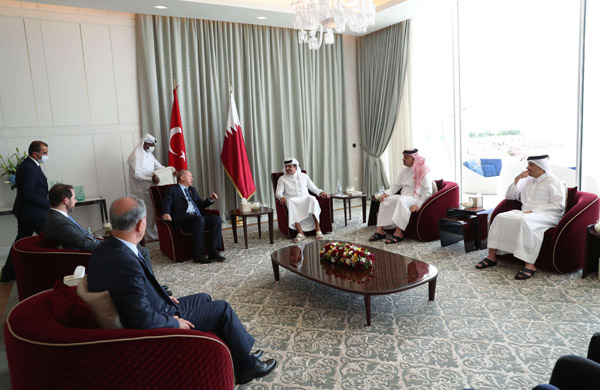 Turkey's President Recep Tayyip Erdogan (C-L), with delegation, meets Qatari Emir, Sheikh Tamim bin Hamad al-Thani (C-R) in Doha, Qatar, July 2. (AFP)